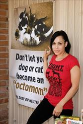 Nadya 'Octomom' Suleman unveils a banner for pet birth control in front of her home on May 19, 2010 in La Habra, Orange, California.