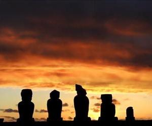 The sun sets behind Moais  -- stone statues of the Rapa Nui culture -- on Easter Island, off the Chilean coast in the Pacific Ocean, on July 12, 2010.