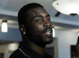 Philadelphia Eagles quarterback Michael Vick answers a question in Philadelphia last month.