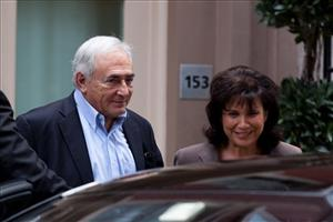 Former International Monetary Fund leader Dominique Strauss-Kahn leaves his temporary residence in Tribeca, Saturday, July 2, 2011, in New York.