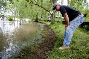 Jim Swanson surveys the oil impact on his property in Laurel, Mont., Tuesday July 4, 2011.