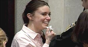 In this image made from video, Casey Anthony smiles as she returns to the defense table after being acquitted of murder charges.