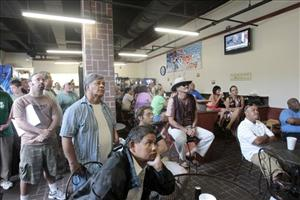 Local residents and visitors watch Judge Belvin Perry on television during the Casey Anthony sentencing in a cafeteria next to the Orange County Courthouse in Orlando, Fla., Thursday, July 7,  2011.