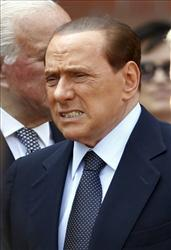 In this June 15, 2011 photo, Italian Premier Silvio Berlusconi arrives to the funeral of late Italian senator Romano Comincioli at the Sant'Ambrogio church, in Milan, Italy.