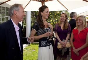 Catherine, Duchess of Cambridge speaks with the CEO of Tusk Charlie Mayhew (L), Kristin Gore (2nd R), and Reese Witherspoon during a reception on July 10, 2011 in Beverly Hills, California.