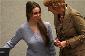 Casey Anthony enters the courtroom with her attorney Dorothy Clay Sims for her sentencing hearing on charges of lying to a law enforcement officer, July 7, 2011 in Orlando, Florida.