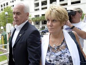 George Anthony, left, and Cindy Anthony, parents of Casey Anthony, arrive at the Orange County Courthouse for Casey Anthony's sentencing in Orlando, Fla., Thursday, July 7, 2011.