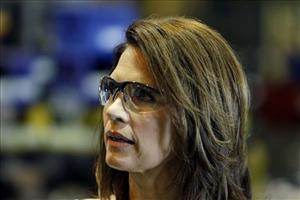 Michele Bachmann campaigns before a crowd of Iowa factory workers.