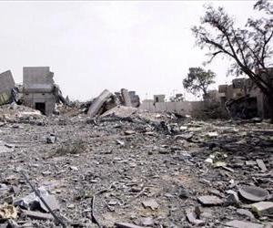 This file photo shows a building destroyed by bombs in Tripoli.