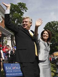 Rep. Michele Bachmann, R-Minn., and her husband Marcus wave to the crowd after her formal announcement to seek the 2012 Republican nomination.