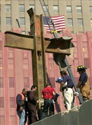 In this October 2001, Father Brian Jordan blesses a cross of steel beams  found amid the rubble of the World Trade Center.