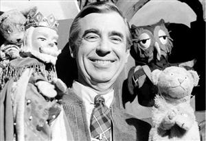 This Jan. 4, 1984 file photo shows Fred Rogers, star of Public Television's Mister Rogers' Neighborhood, as he rehearses with some of his puppet friends in Pittsburgh, Pa.