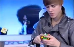Justin Bieber works on a Rubik's Cube in this frame grab from YouTube.