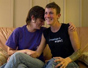 In a July 25, 2011 photo, lesbian couple Jennifer Tipton, left, and Olivier Odom are seen at a coffee house in Knoxville, Tenn.