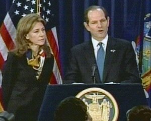 In this video frame grab image taken from AP Television News, New York Gov. Eliot Spitzer, with his wife Silda standing by, announces he is resigning following intense pressure to step down because of a prostitution scandal, Wednesday March 12, 2008 in New York. Spitzer says his resignation is effective...
