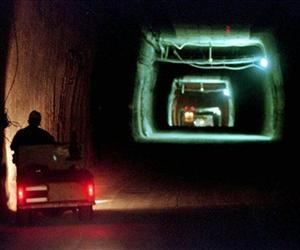 A worker drives a cart through a tunnel inside the Waste Isolation Pilot Plant 2,150 feet below the surface near Carlsbad, NM, in this April 8, 1998 file photo.
