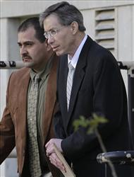 Warren Jeffs, right, is escorted out of the Tom Green County Courthouse Friday.