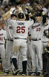 Minnesota Twins' Jim Thome (25) is greeted by teammates after hitting his 600th career home last night against the Detroit Tigers.