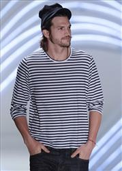 Ashton Kutcher wears a creation from the Colcci collection at the Sao Paulo Fashion Week early this summer.