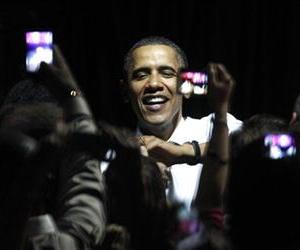 President Barack Obama is surrounded by camera phones as he shakes hands with the audience at a fundraiser on the eve of his 50th birthday, Aug. 3, 2011, in Chicago.