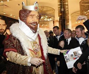 Burger King's soon-to-be ex-mascot The King appears at a promotional event for the X-Box Kinect in this Nov. 4, 2010 file photo.
