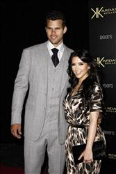 In this Aug. 17, 2011 file photo, reality TV personality Kim Kardashian, right, and her fiance, NBA player Kris Humphries, arrive at the Kardashian Kollection launch party.