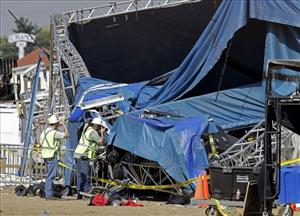 Investigators examine the stage that collapsed on Saturday at the Indiana State Fair in Indianapolis, Wednesday, Aug. 17, 2011.