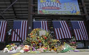 A patron stops and views a memorial in front of the Grandstand at the Indiana State Fair in Indianapolis,  Wednesday, Aug. 17, 2011.
