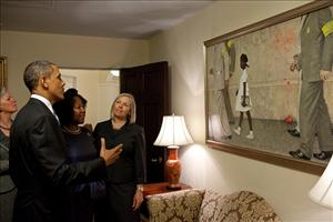 President Obama and Ruby Bridges look at Norman Rockwell's The Problem We All Live With.