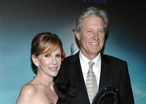 In this Dec. 11, 2010 file photo, actor Bruce Boxleitner, right, and actress Melissa Gilbert arrive at the premiere of the feature film Tron: Legacy in Los Angeles.