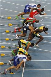 Jamaica's Usain Bolt, fourth from bottom, false starts from the Men's 100m final at the World Athletics Championships in Daegu, South Korea, Sunday, Aug. 28, 2011.
