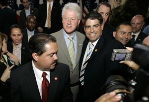 Puerto Rico's Senator Roberto Arango, right, posing for a photo with former US President Bill Clinton back in 2008.