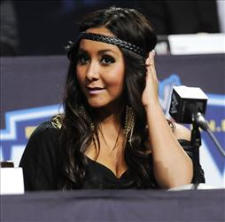 In this March 30, 2011 file photo, reality television star Nicole Snooki Polizzi participates in a Wrestlemania XXVII news conference at the Hard Rock Cafe in New York.