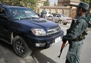 An Afghan policeman stands guard in front of a vehicle in Kabul, Afghanistan, in this Thursday, June 23, 2011, file photo.