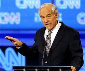 Republican presidential candidate Rep. Ron Paul, R-Texas, gestures during a Republican presidential debate Monday, Sept. 12, 2011, in Tampa, Fla.