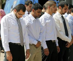 Four students, from left, Taher Herzallah, Mohammad Qureashi, Aslam Traina, and Mohamad Abdelgany pray outside court after being convicted.