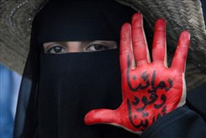 A protester shows her painted hand during a demonstration demanding the resignation of President Ali Abdullah Saleh in Sanaa, Yemen. The message reads, Our blood is fuel for our revolution.