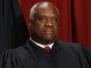 Associate Justice Clarence Thomas sits with other Supreme Court judges for a new group photograph, Tuesday, Sept. 29, 2009, at the Supreme Court in Washington.