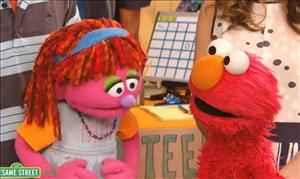 Lily talks to Elmo about visiting food banks.