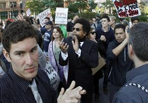Princeton University professor Cornel West, center, joins Occupy Boston protesters rallying in Boston Wednesday.