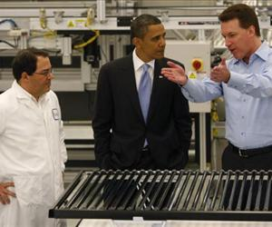 Ben Bierman (left) and Chris Gronet (right) explain solar technology to U.S. President Barack Obama on a tour of the Solyndra solar panel company May 26, 2010 in Fremont, California.