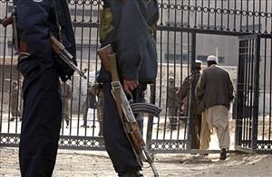 Afghan security police officers stand guard in front of the Pul-e Charkhi prison's gate in Kabul, Afghanistan in this file photo.