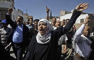 Yemeni activist Tawakul Karman, center, and other demonstrators chant anti-government slogans during a protest in Sanaa, Yemen, Saturday, Jan. 29, 2011.