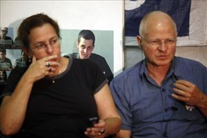 Gilad Shalit's parents, Aviva and Noam, talk in a protest tent set up outside the Prime Minister's residence in Jerusalem.