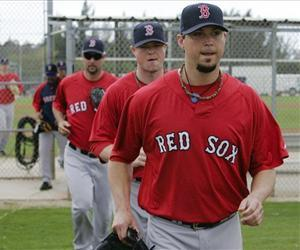Boston Red Sox pitchers from front,  Josh Beckett, Jon Lester and Tim Wakefield run to a training field, during spring training in Fort Myers., Feb. 20, 2010.