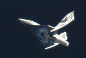 This image provided by Virgin Galactic shows SpaceShipTwo in full feather wing mode on a rapid descent from its drop altitude of 51,500 feet.