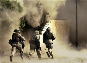 In this 2004 file photo, US marines detonate explosives during a mission in Ramadi, Iraq.