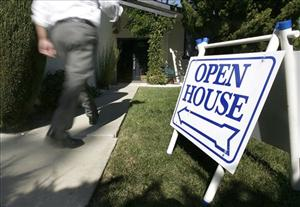 A buyer walks into a open house that is for sale in San Jose, Calif., on Sunday, Oct. 7, 2007.