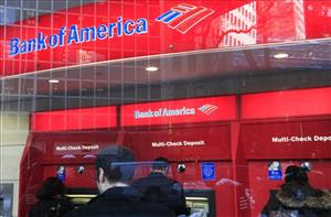In this Jan. 31, 2011 photo, Bank of America customers use ATMs in New York.