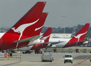 Qantas passenger jets at their terminal at Sydney Airport in a file photo.